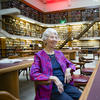 Woman in chair in library