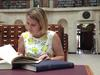 Girl reading books in Mitchell reading room