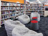 Internal view of library with beanbag seats and bookshelves