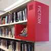 Library shelves with collection signage