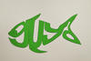 The word guya drawn in the shape of a fish on green cardboard