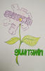 The word guurrawin traced and outlined into the shape of a flower