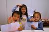3 children making monster faces