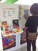 Woman looking at information on the Drug and Alcohol Info Hub display