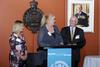 Woman receiving award, standing at a podium