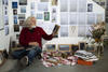 Library artist in  Hadyn Wilson in his studio, photographed by Joy Lai.
