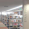 Library shelves with signs for information, great reads and large print