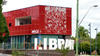 External view of red building with library sign