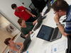 A group of people attending a coding workshop