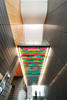 Internal stairs with a multicoloured glass ceiling
