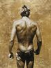 Image of the back of a man wearing budgie smugglers. Gold leaf has been applied to the image.
