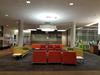 Multicoloured lounge seats in open plan area