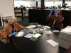 Library volunteers Zoe Middleton and John McIntyre Grimau get to work rehousing negatives