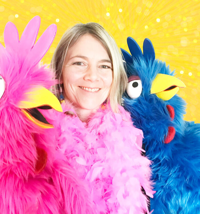 Author Lucinda Gifford and chicken puppets
