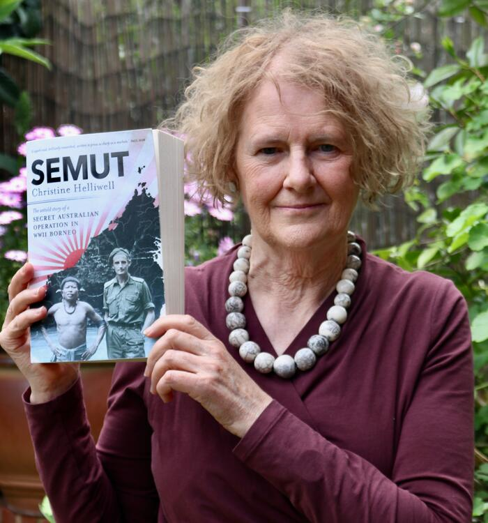 Author Christine Helliwell holding a copy of her book Semut