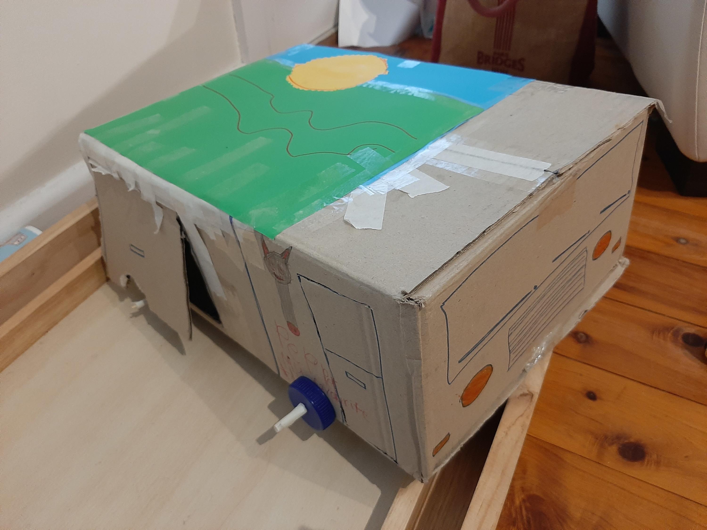 A cardboard sculpture made by an Art Club member