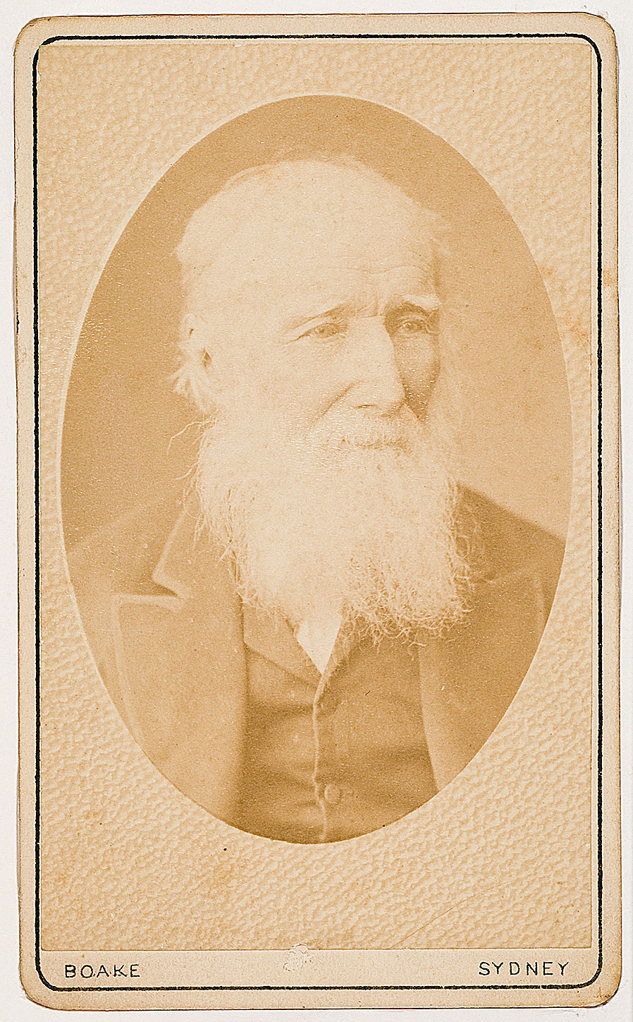 An old, sepia portrait of a white, bearded man.