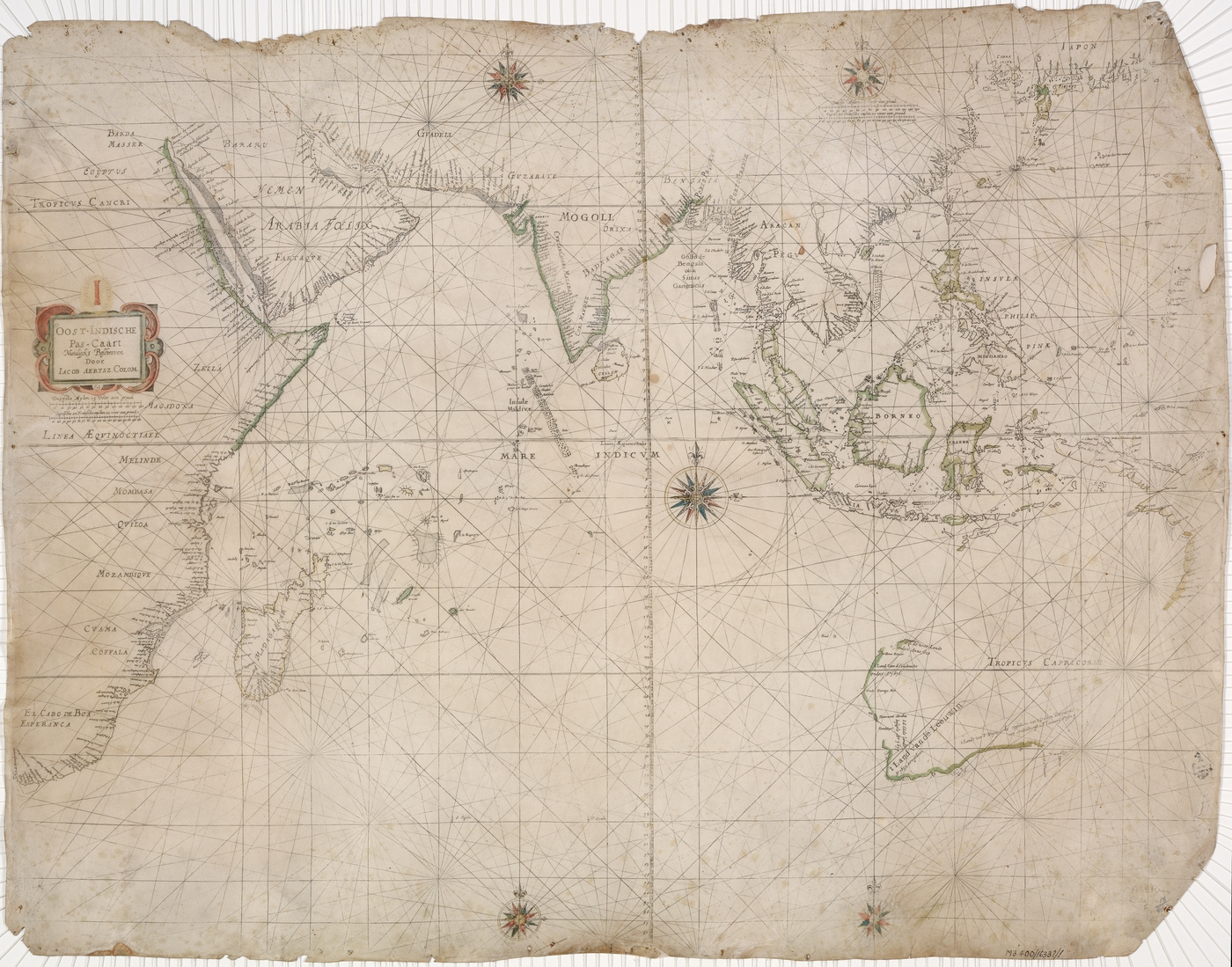 A historical map with worn edges, showing the east coast of Africa, West Coast of Australia and large parts of Asia. The rest of the world is unmapped.